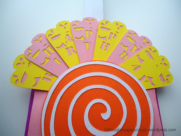 Close up of the full fan. Happy Birthday message in yellow and pink lettering