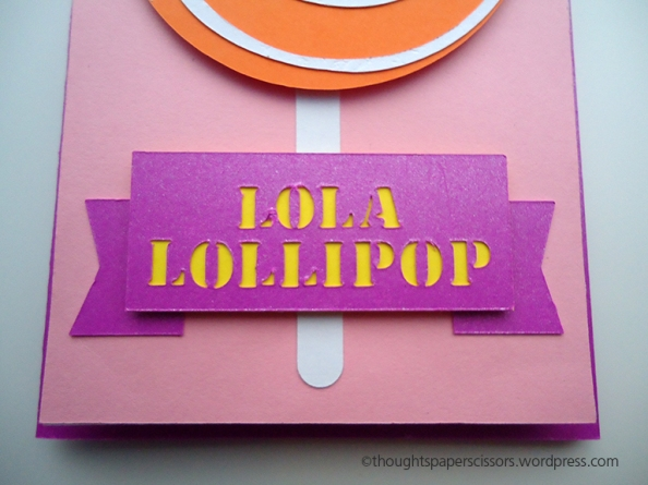 Close up of purple banner with cut out letters with yellow backing