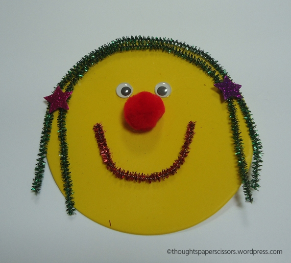 My first sample - a smiley girl pipe cleaner hair, pom pom nose, stick on eyes and starry hair accessories