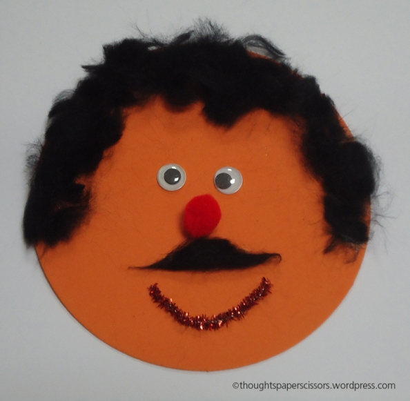 My third sample. Man smiley using a cut up pom pom for the hair and moustash
